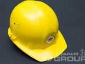 Желтые каски с логотипом «Безопасность»