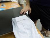 Белые футболки с логотипом и надписью «QLEANSERVICE»