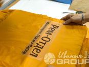 Оранжевые ветровки с надписью «РЕМ ОТДЕЛ»