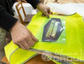 Желтые сигнальные жилеты с изображением «Технология движения»