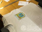 Белые футболки с гербом «В движении жизнь»